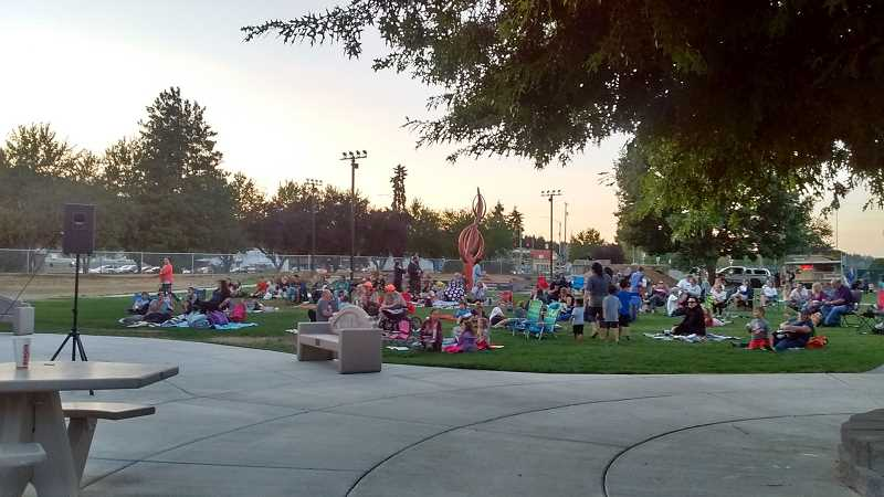 COURTESY PHOTO: JEFF WEISS, SCAPPOOSE PUBLIC LIBRARY DISTRICT - Kids and adults gather for a movie in Heritage Park in 2018. The summer event took place again in 2019, but didn't happen in 2020.