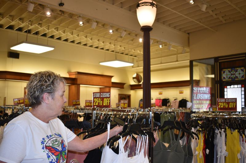 PMG PHOTO: ANGEL ROSAS  - With new clothing coming in each day, employee Dawn Wallander still has a lot of work to do before the store closes for good.
