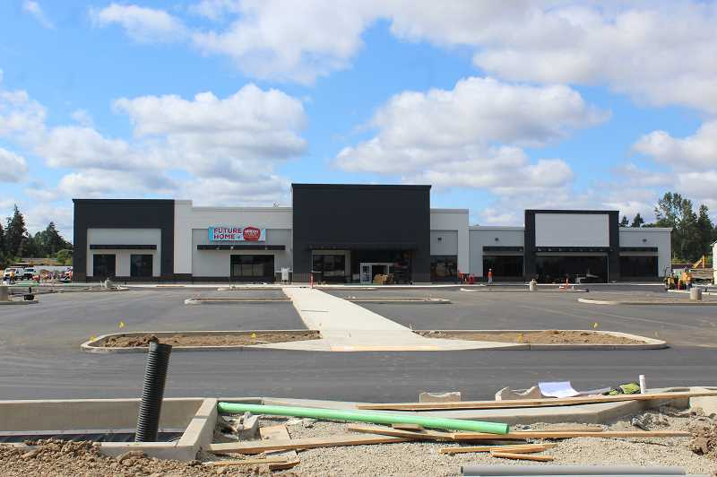 PMG PHOTO: KRISTEN WOHLERS - The Molalla Grocery Outlet building is nearing completion, with an expected opening date of Aug. 19.