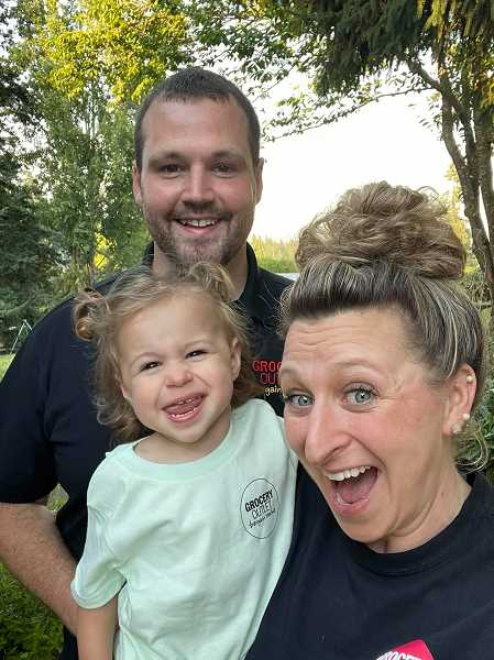 COURTESY PHOTO - Molalla Grocery Outlet owners Racheal and Brandon Donnelly pose for a photo with their 2-year-old daughter, Olivia.