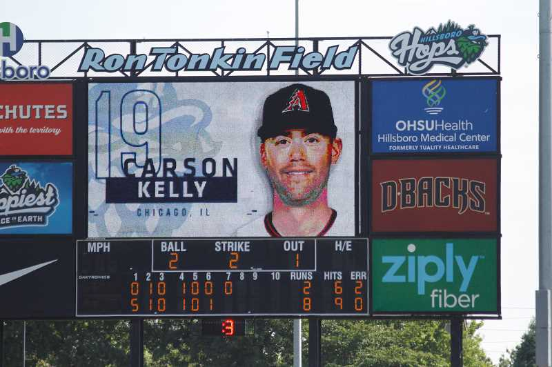 PMG PHOTO: WADE EVANSON - The big screen at Ron Tonkin Field announces Carson Kelly's at-bat during the Hops game July 28. Kelly is in Hillsboro rehabbing a fractured wrist.