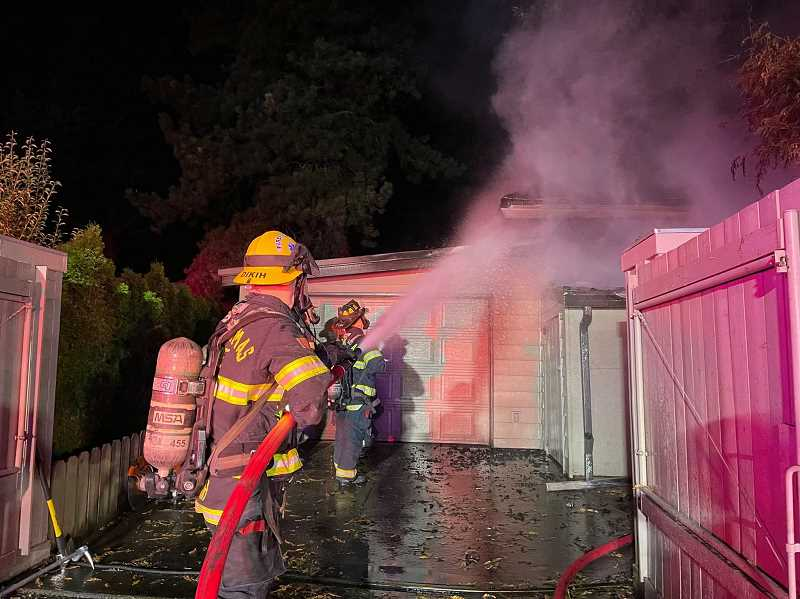 COURTESY PHOTO: CLACKAMAS FIRE - Fire damage to the Washington Street garage structure is estimated in excess of $50,000.