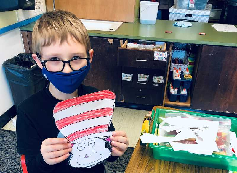 COURTESY FILE PHOTO - Lucas Baldridge shows off a craft project after returning to the school building in March 2021.