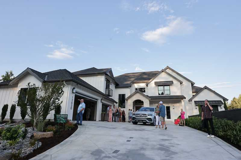 PMG PHOTO: JONATHAN VILLAGOMEZ - NW Natural Street of Dreams opened July 28 in Happy Valley. The biggest and most costly of the of the two homes built by Red Hills homes is called Zion, a 7,300-square-foot, five bedroom, five-and-a-half bath Tuscan-style farmhouse (with basketball half-court) owned by a sports entertainment executive and former football player.