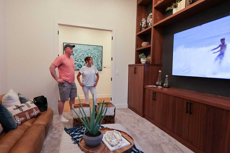 PMG PHOTO: JONATHAN VILLAGOMEZ - NW Natural Street of Dreams opened July 28 in Happy Valley. Checking out the lounge were Mike Nash and Jennifer Bradshaw at a Red Hills home Number 2 called Ohana.