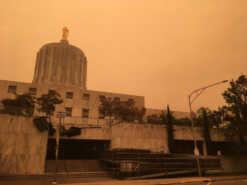 PMG PHOTO: PETER WONG - The Oregon Capitol in Salem in the early afternoon of Sept. 8, 2020, a day after the start of the Labor Day wildfires that swept the state. An unusually strong wind from the east blew smoke from the Beachie Creek and Lionshead wildfires into Salem and resulted in a red-orange tint in the sky.