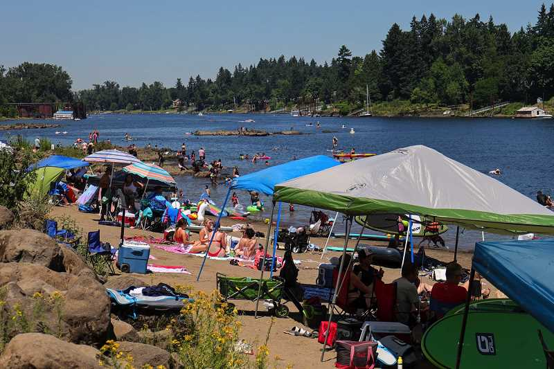 PMG PHOTO: JONATHAN VILLAGOMEZ - Oregon families camped out on the Clackamas River on Saturday, June 26.