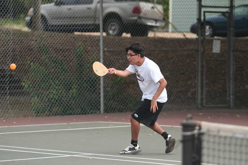 PMG PHOTO: TANNER RUSS - Ivan Tiburcio, 16, took up pickleball as a fun distraction and a way to get in some exercise for the fall and spring sports seasons.
