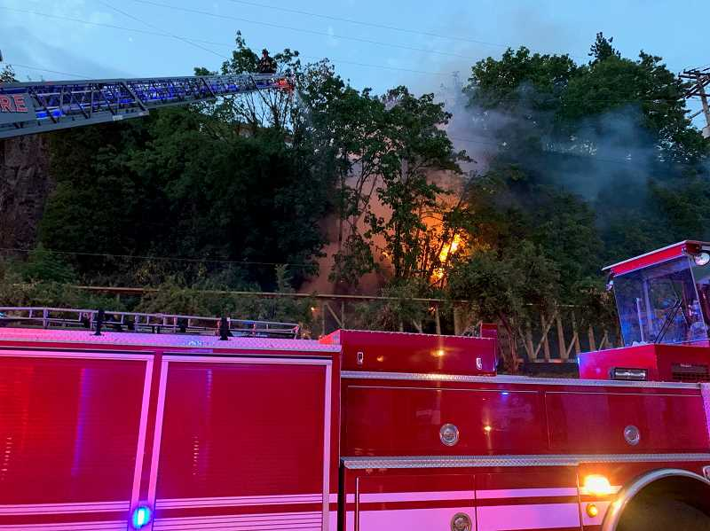 COURTESY PHOTO: CLACKAMAS FIRE - An Aug. 1 blaze was spotted by Oregon City citizens at the bottom of the McLoughlin bluff moving quickly uphill toward High Street structures.