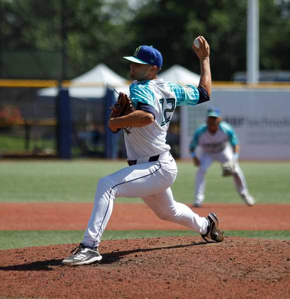 PMG PHOTO: WADE EVANSON - Hillsboro's Slade Cecconi hurls a pitch during the Hops game against Tri-City Wednesday, July 28, at Ron Tonkin Field in Hillsboro.