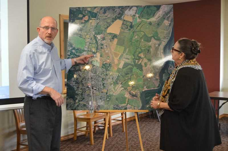 PMG FILE PHOTO - Boeing program manager Bill Gerry and Sen. Betsy Johnson look over a map of Scappoose in 2017. What is currently one building will eventually grow to be a district with industry offices, Johnson said in 2017.
