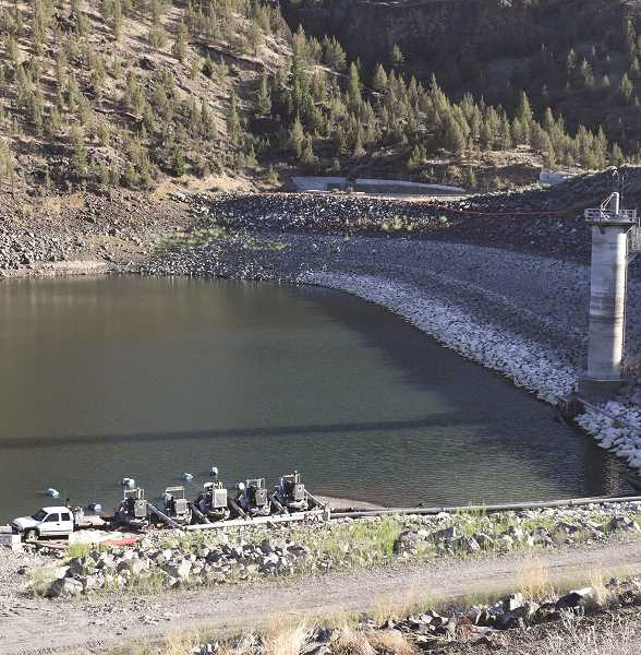 RAMONA MCCALLISTER - Equipment is put in place to pump water out of the dead pool portion of Ochoco Reservoir and into the irrigation system for customers that rely on the water.