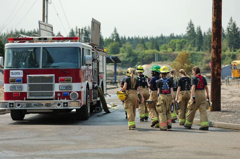 PMG PHOTO: JONATHAN VILLAGOMEZ - The yearly Metro Fire Camp is back after a year's hiatus. Tualatin Valley Fire & Rescue holds a three-day camp, led entirely by female firefighters, for young woman between the ages of 18 to 20 years old where they get hands-on firefighter training.