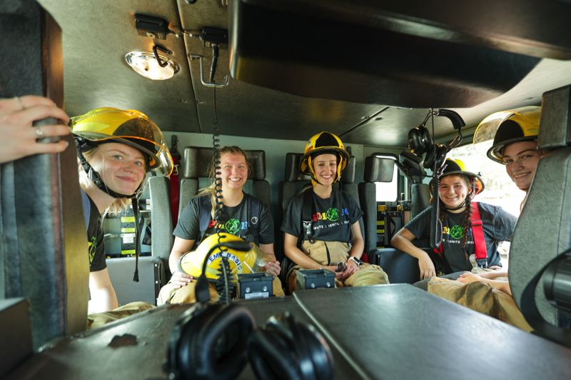 PMG PHOTO: JONATHAN VILLAGOMEZ - From left to right, Linda Casey, Maddi Ball, Rose Amberwood, Sorelle Bregman and Cierah Binder got the opportunity to check out the inside of a fire engine during the three-day Metro Fire Camp.