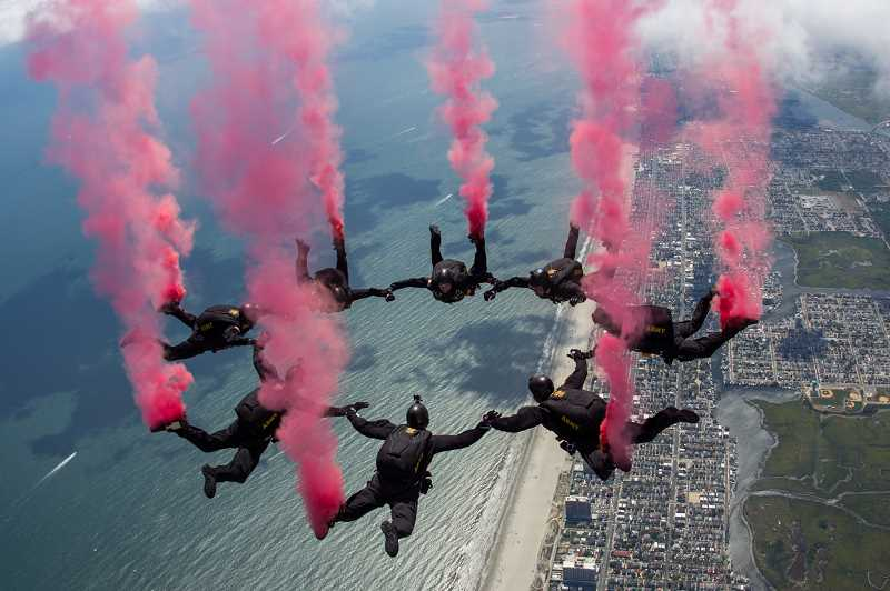 SUBMITTED PHOTO  - The Golden Knights are one of only three Department of Defense-sanctioned aerial demonstration teams. The team will jump both night and day Friday and Saturday during the 20th Anniversary Airshow of the Cascades, Aug. 27-28.