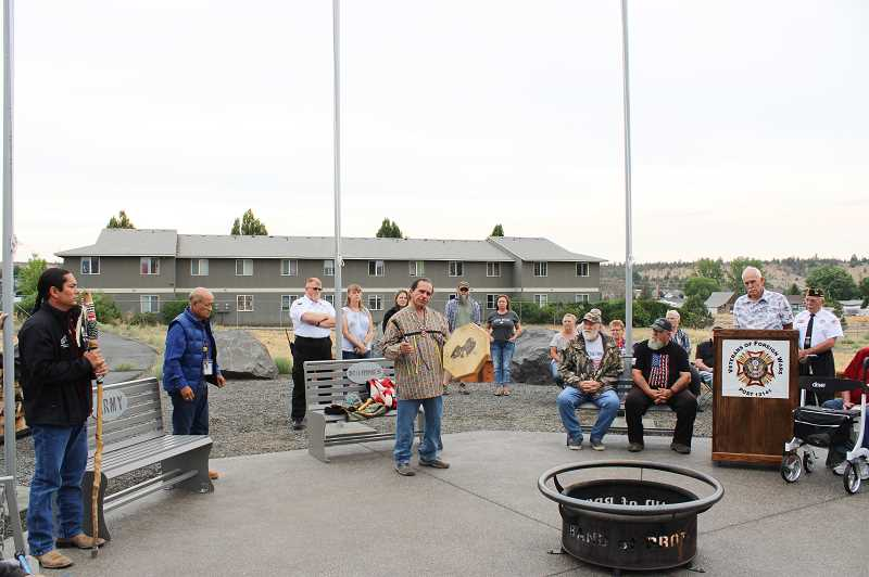 JENNIFFER GRANT/MADRAS PIONEER  - Local veteran Mike Williams performed a chant with a drum during the ceremony.
