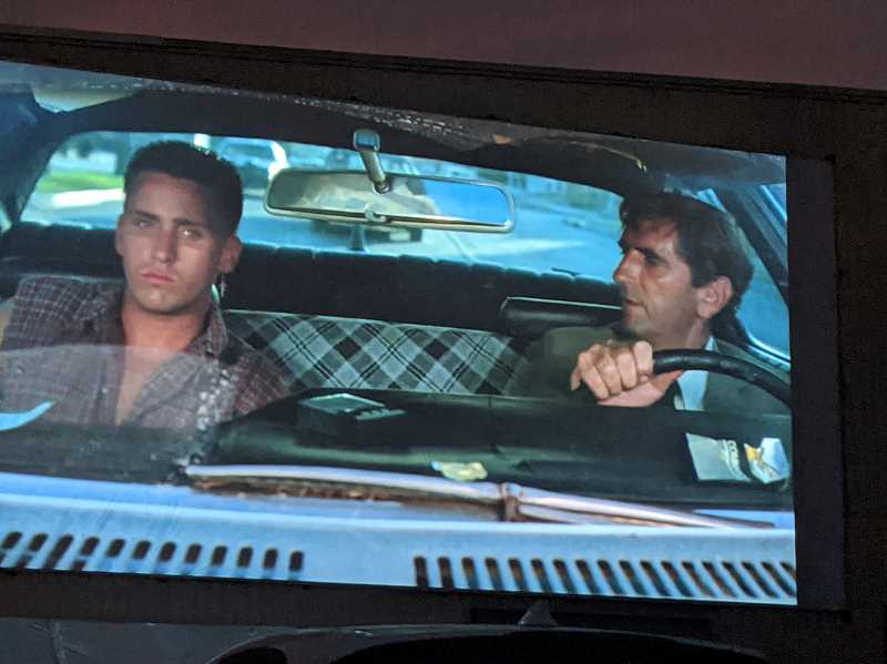 PMG PHOTO: JOSEPH GALLIVAN - When Harry met Emilio: a scene from Repo Man where Emilio Estevez learns form Harry Dean Staton (right) how to repossess a car in 1980s Los Angeles. As shown at Portland Expo Center's PDX Drive-in?Movie?Spectacular runs now through Aug. 28.