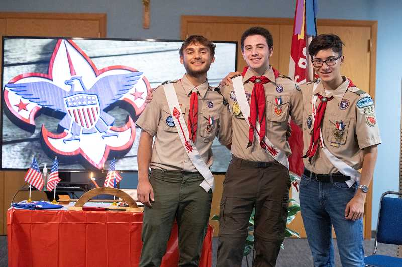 PMG PHOTO: JONATHAN HOUSE - From left, Ethan Fullman, Scott Gevurtz and Conrad Heyns celebrate becoming Eagle Scouts.