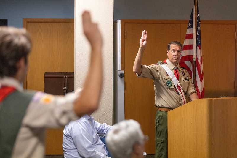 PMG PHOTO: JONATHAN HOUSE - Assistant Scoutmaster Chris Rich leads with the Eagle Scout Pledge during a ceremony on Monday.