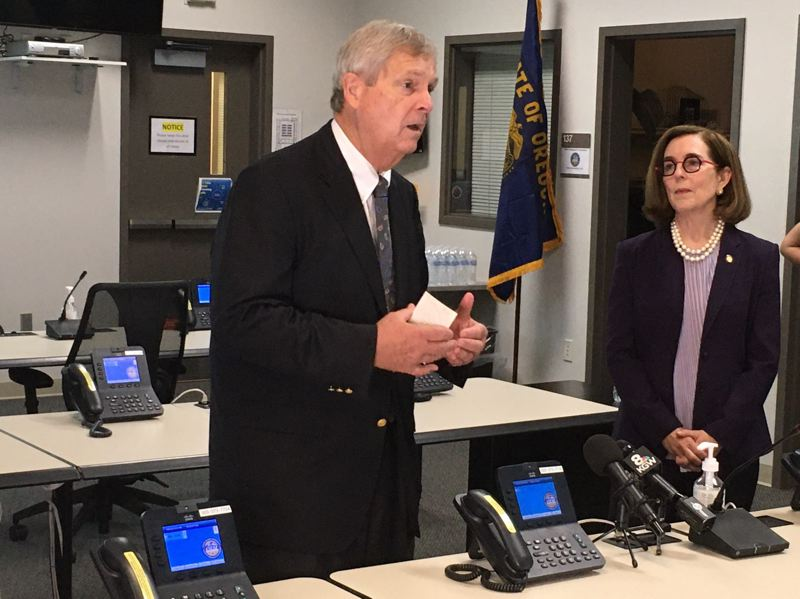 PMG PHOTO: PETER WONG - U.S. Agriculture Secretary Tom Vilsack speaks with reporters at the state's Emergency Operations Center in Salem after he and Gov. Kate Brown were briefed on the status of wildfires, including the Bootleg fire northwest of Klamath Falls in the Fremont-Winema National Forest. Vilsack and Brown also visited a farm near Salem on Tuesday, Aug. 3.