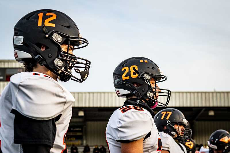 COURTESY PHOTO: JOSI WELTER - Scappoose football players stand ready at their only game against St. Helens in the 2020-2021 school year.