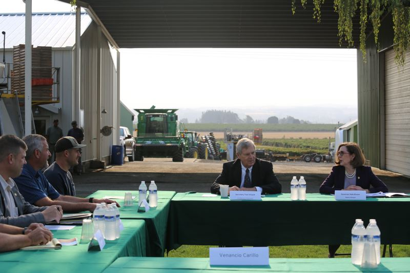 COURTESY PHOTO: GOVERNOR'S OFFICE - U.S. Agriculture Secretary Tom Vilsack and Gov. Kate Brown talked with a handful of Willamette Valley farmers near Salem about difficulties they face.
