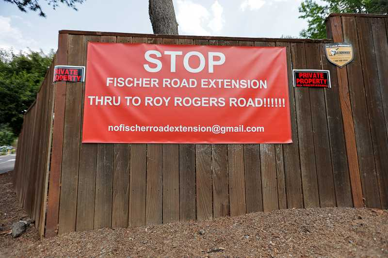 PMG PHOTO: JONATHAN VILLAGOMEZ  - A large sign off of Fischer Road expresses opposition by some neighbors for any plans to extend Fischer Road. However, King Citys mayor and city council president said theres a lot of misinformation being distributed such as that extending the roadway would increase crime.