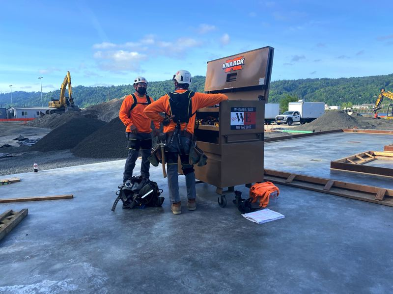 """COURTESY PHOTO: SAIF - Employees at Whitaker Ellis Builders Inc., a Tigard-based concrete contractor, participate in a pilot to test how exoskeletons, or """"exosuits,"""" may reduce back injuries and improve worker safety in the construction industry."""
