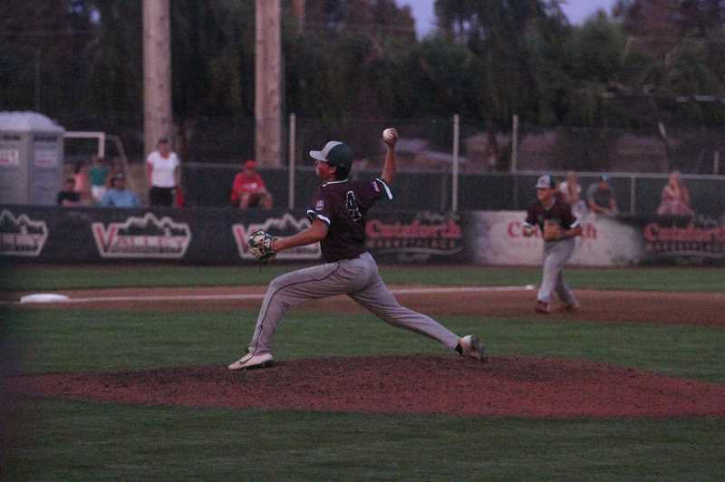 PMG PHOTO: TANNER RUSS - North Marion pitcher Hunter Hansen gave up no runs in the five innings he led from the mound en route to the Berries 6-0 win over Alpenrose on August 4.