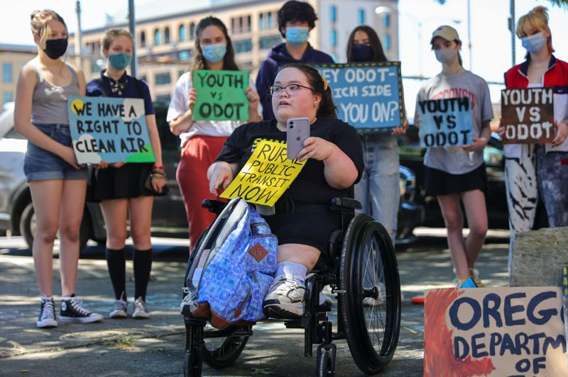 PMG PHOTO: JONATHAN VILLAGOMEZ - Climate activist Cassie Wilson speaks outside ODOT's office in Portland during a recent rally.
