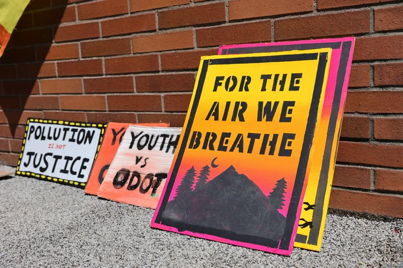 PMG PHOTO: JONATHAN VILLAGOMEZ - Protest signs lean against a wall during a youth-led rally at the Oregon Department of Transportation's headquarters last month.