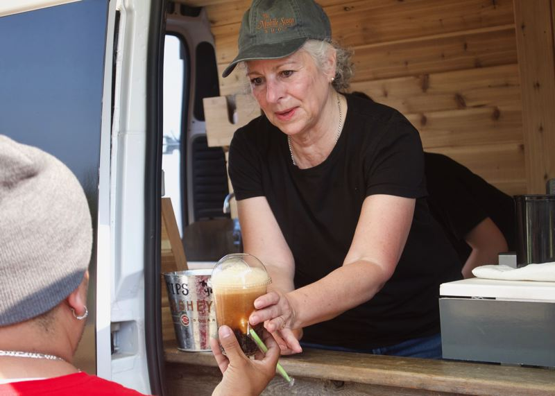 PMG PHOTO: CHRISTOPHER KEIZUR - The Mobile Scoop Shop teamed up with Gresham first responders to pass out root beer floats.