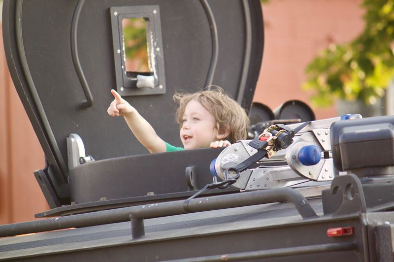 PMG PHOTO: CHRISTOPHER KEIZUR - A young Gresham resident sticks his head out the top of a SWAT vehicle that was on display during National Night Out.