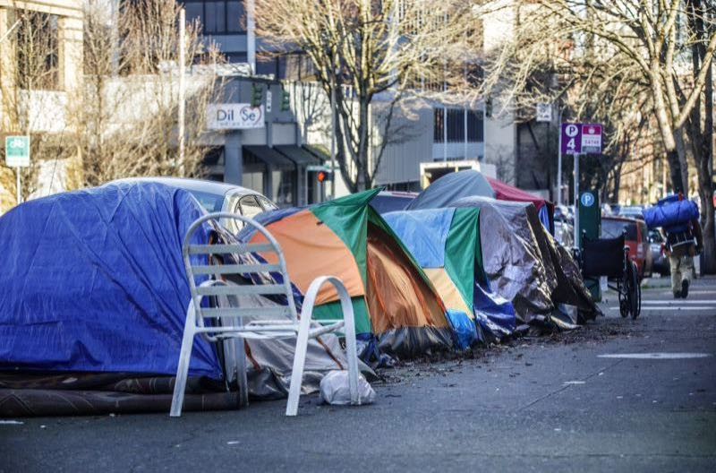 PMG FILE PHOTO - Tents along a downtown street.