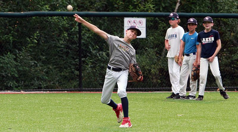 PMG PHOTO: MILES VANCE - Lake Oswego outfielder Luke Smith makes a throw during practice on Thursday, Aug. 5. Smith and the rest of the LO Little League Majors all-stars open play in the Pacific Northwest Regional tournament on Sunday, Aug. 8.