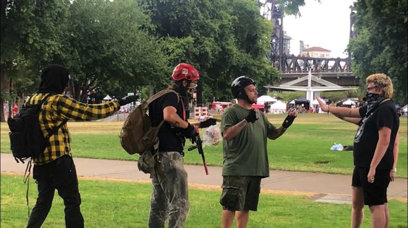 PMG PHOTO: ZANE SPARLING - Left- and right-wing groups clashed in downtown Portland's waterfront park on Saturday, Aug. 7.