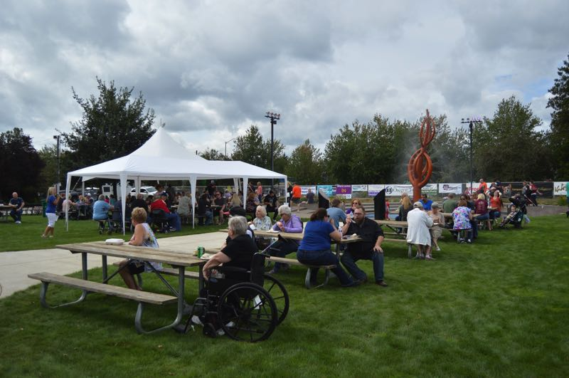 PMG FILE PHOTO - Visitors sit in Heritage Park, near food vendors and the gazebo, at the 2019 Sauerkraut Festival.