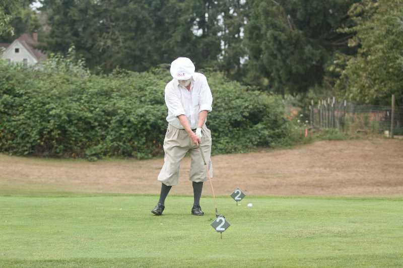 PMG PHOTO: TANNER RUSS - Golfers came to the Oregon Hickory Open dressed in old-fashioned apparel and using old-fashioned clubs.