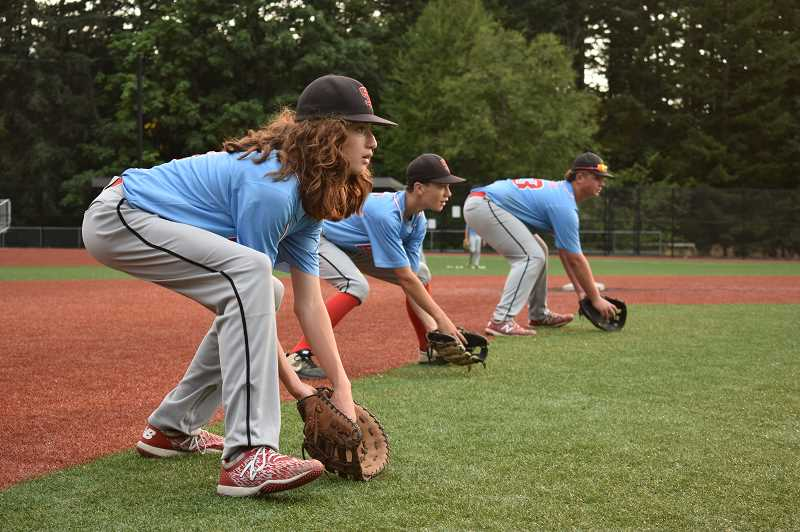 PMG PHOTO: ANGEL ROSAS  - Sandy Pack infielders working on ground outs during a recent practice.