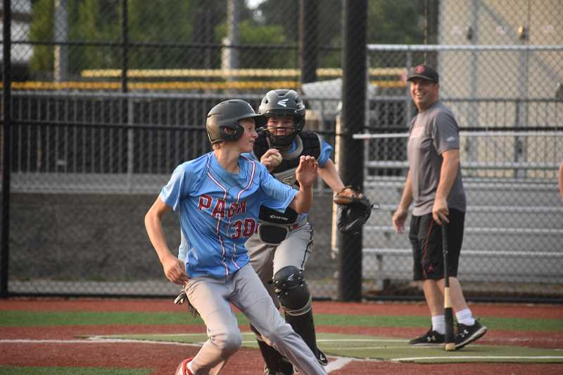 PMG PHOTO: ANGEL ROSAS  - Catcher Fisher Winchester tags out Hunter Dunham as he retreats to third base.