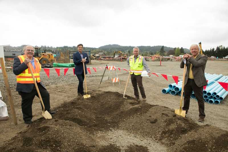 COURTESY PHOTO - Happy Valley Mayor Tom Ellis, The Springs Living Founder/CEO Fee Stubblefield, R&H Construction CEO John Ward and Gramor Development President Barry Cain break ground in April on a new senior community.