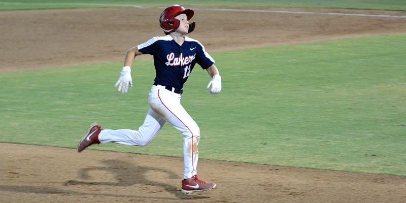 COURTESY PHOTO: KATE COOK - Lake Oswego's Ethan Uecker races to third base in the third inning of his team's 11-0 win over Wyoming in the Pacific Northwest Regionals at San Bernardino, California, on Wednesday, Aug. 11.