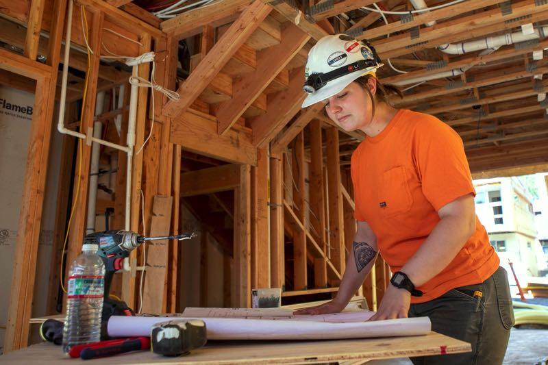 """PAMPLIN MEDIA GROUP: JAIME VALDEZ - Dakota Quinn, a 27-year-old union electrical foreman with Merit Electric and IBEW Local 48, advises teens: """"Be familiar with drills, sawzalls, hammers, know how to read a tape measure…basic construction tools. That would be more important than knowing the math and stuff."""", Business Tribune - News Estacada electrician says her career wouldn't have been possible without her NECA-IBW apprenticeship Electrial apprenticeship key to local foreman's success"""