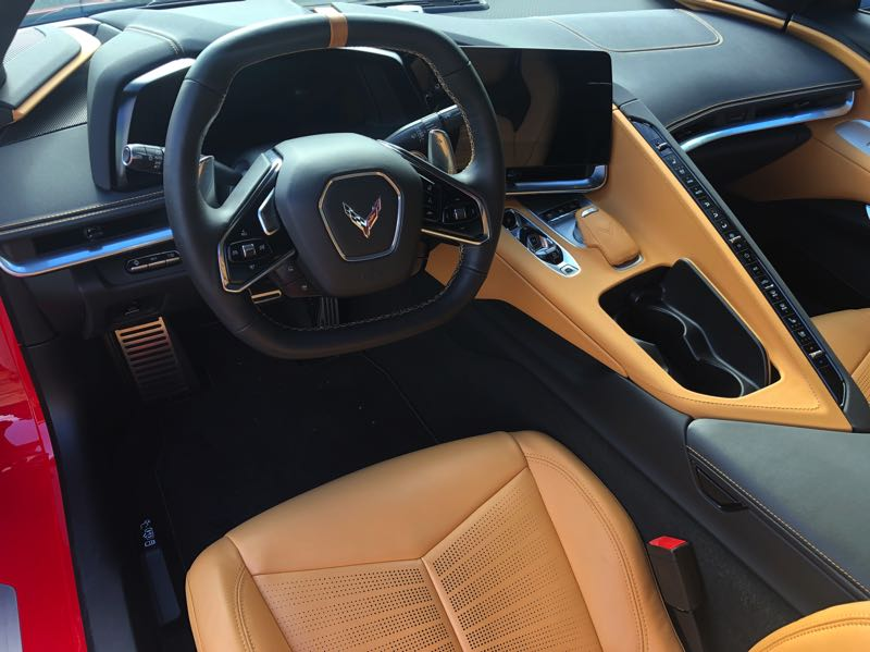 PMG PHOTO: JEFF ZURSCHMEIDE - The interior of the 2022 Chevy Corvette is another radical departure from tradition, with climate and other controlns between the driver and the passenger.