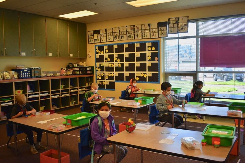 PMG FILE PHOTO - Students at Hogan Cedars Elementary in Gresham learn while wearing face masks and maintaining social distance.
