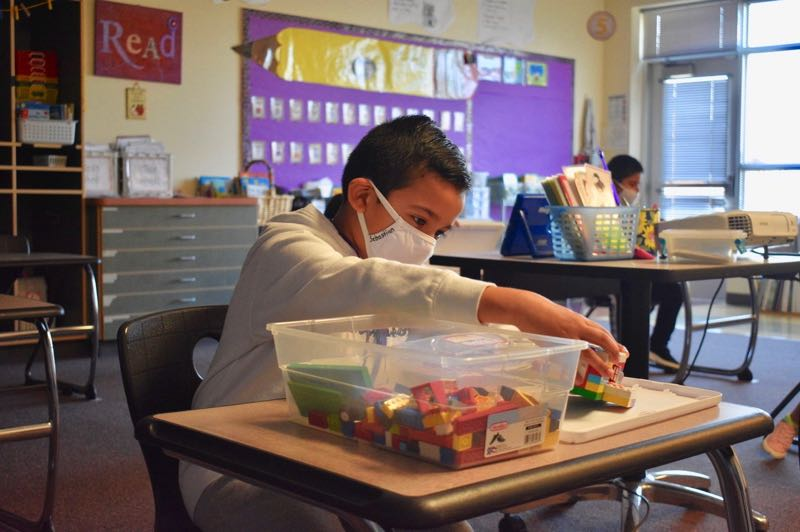 PMG FILE PHOTO - A young student at Hogan Cedars Elementary School in Gresham wears a face mask while working in class.