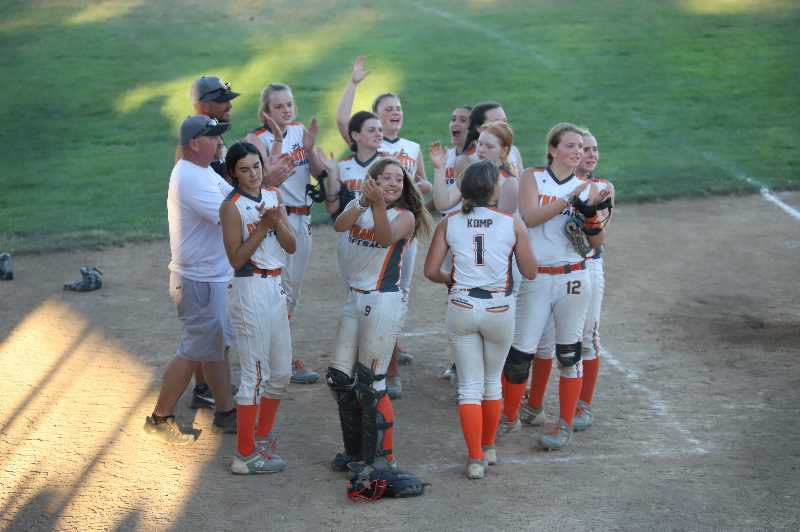 COURTESY PHOTO: JENNIFER KOMP - Scappoose Dynamite players cheer during a game at the Scappoose Centennial tournament.