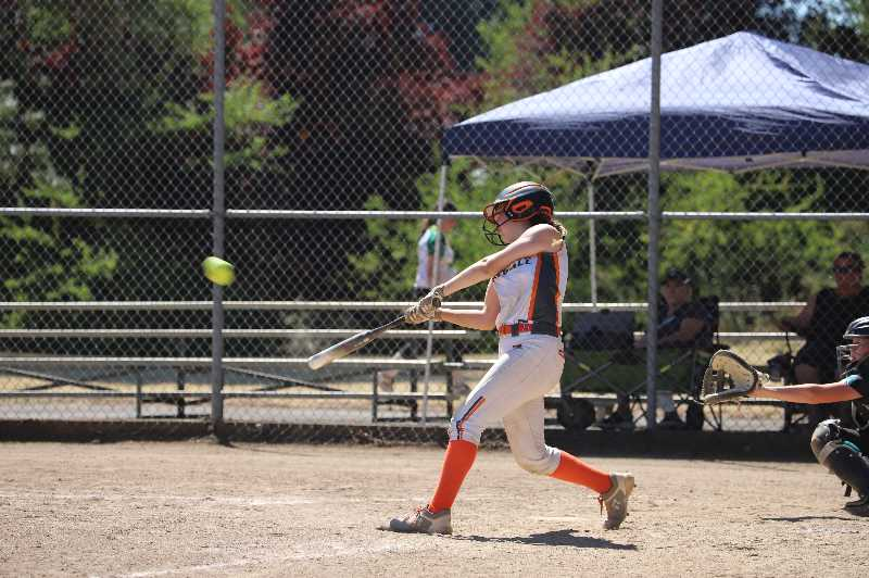 COURTESY PHOTO: JENNIFER KOMP - A Scappoose Dynamite player swings for the ball.