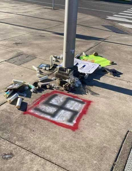 PHOTO COURTESY: OCPD - Clackamas County Surveyor Collin Michael Williams reportedly painted this swastika next to a memorial for Jermelle Madison, a Black man who died in the hospital.