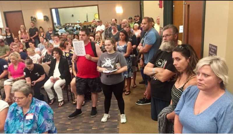 PHOTO COURTESY: KOIN 6 NEWS - An overflow crowd filled the room at a Clackamas County commission meeting about the mask mandate on Aug. 12.
